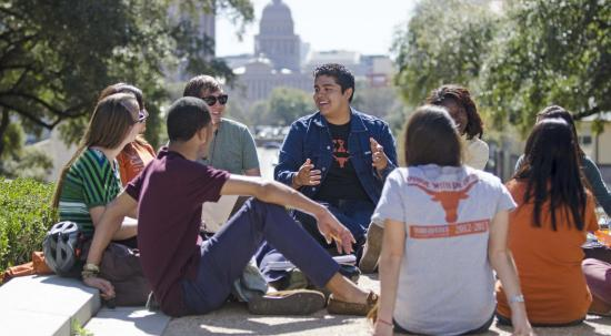 UT Austin students sit and discuss on the south mall