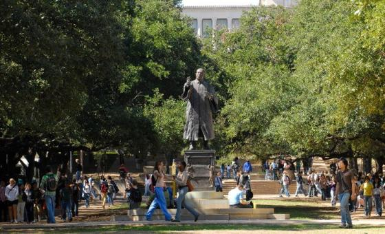 Students walking on the East Mall by the Martin Luther King Jr. Fountain