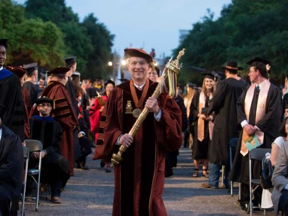 University of Texas professor walking during commencement