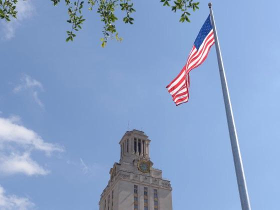 UT Tower with U.S. flag waving
