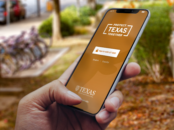 Hand holding phone using Protect Texas App
