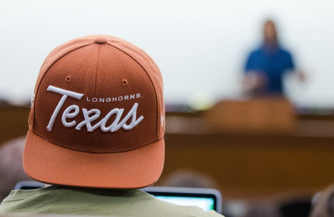 University of Texas hat on student in class