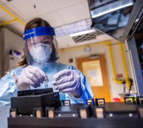 Researcher working in lab wearing protective gear
