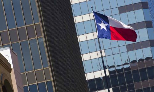 View of downtown building with Texas flag
