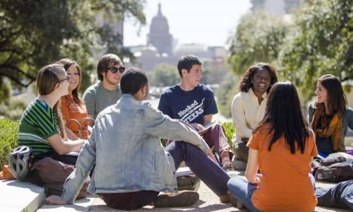 Group of students on the south mall with the state capitol in the distance.