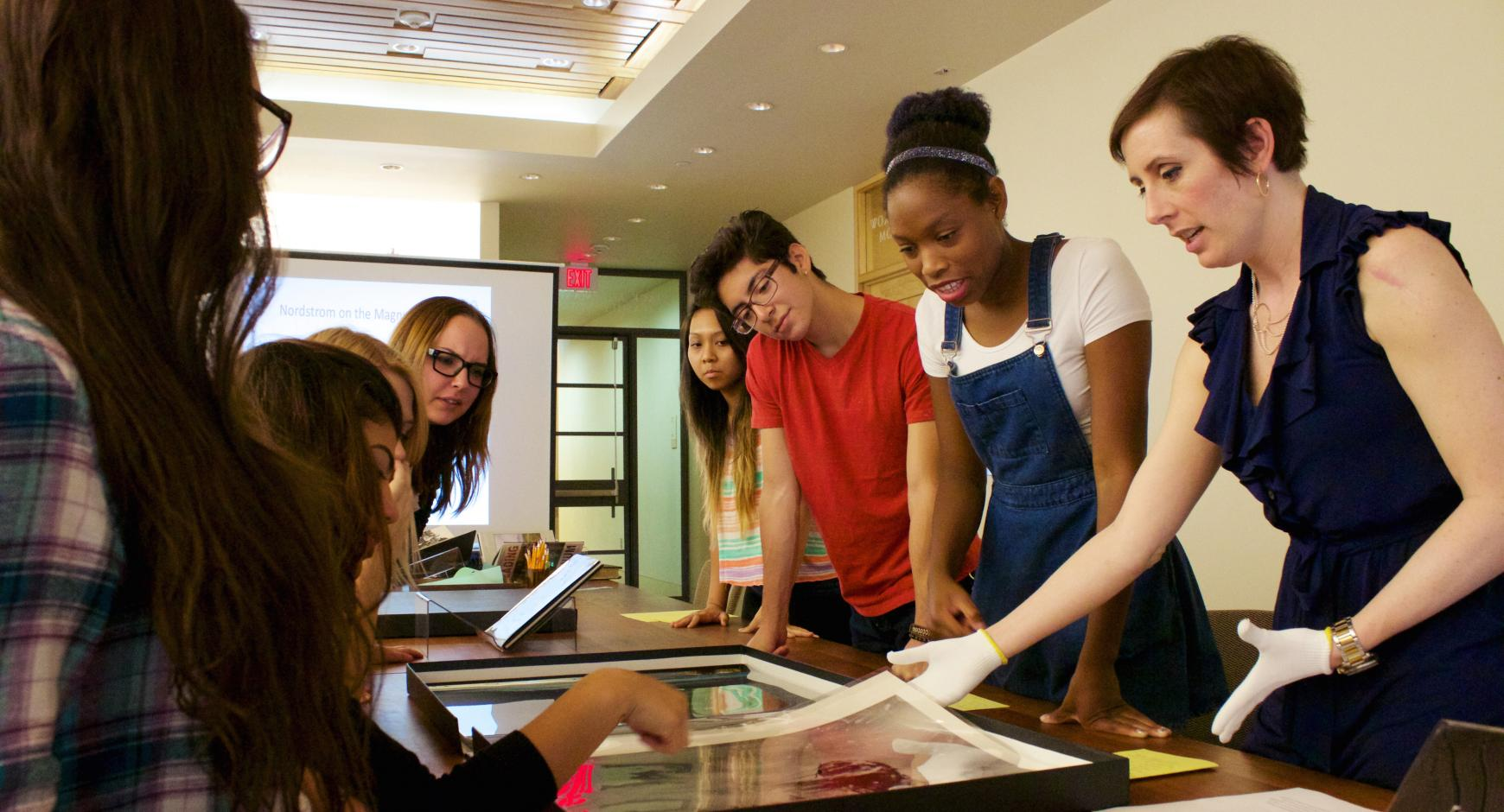 Students examine archival photos at the Harry Ransom Center