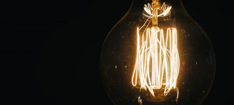 Commercializing Breakthroughs, lightbulb glowing in darkness