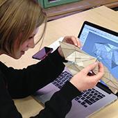 Student examines geometric model.