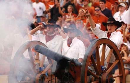 Texas Cowboys fire Smokey the Cannon at a football game.