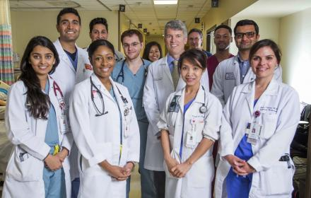 Dean Clay Johnston with doctors and clinicians