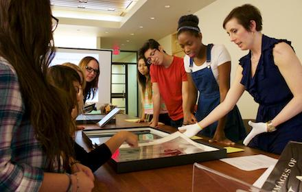 Student researchers examine object.