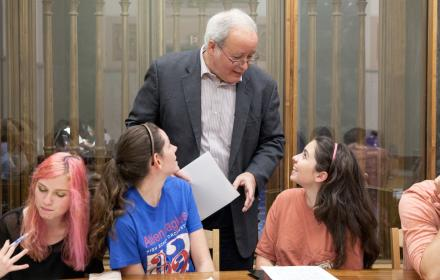 Faculty member talking with students.