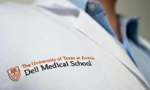 Lab coat with Dell Medical School logo