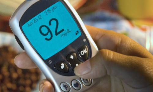 Person using a diabetes monitor.