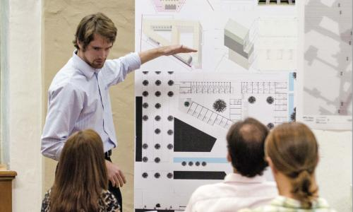 Architecture final critique with students presenting their work in Goldsmith Hall