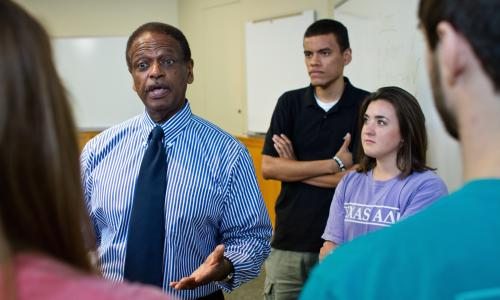 Marketing faculty member Herb Miller talking with students in class.