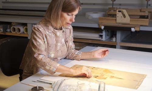 Faculty member Karen Pavelka preserving information artifacts in lab.