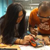 Students tinker with a project in Longhorn Maker Studio.