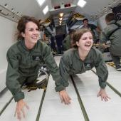 Aerospace engineering students in space simulation.