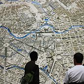 Students examining large map of city.