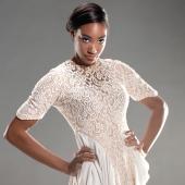 Model posing in dress.