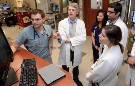 Dean Clay Johnston talks with hospital staff.