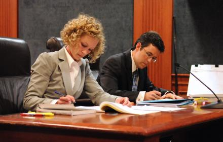 Lawyers preparing for case.