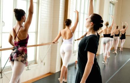 Dance students practicing in studio.