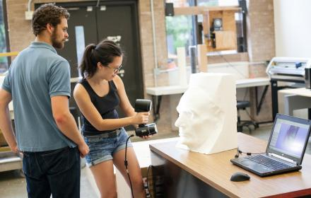 Student performs 3D scan of a sculpture.