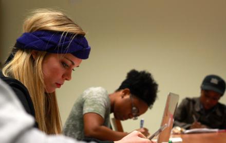 Undergraduate researchers analyzing stuttering data in Prof. Courtney Byrd's lab