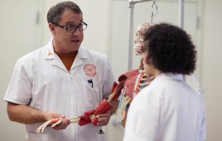Nurses discussing musculoskeletal model.