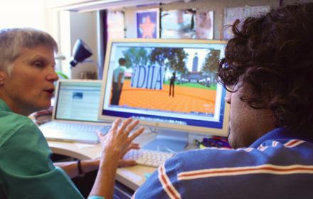 Student receiving training on computer program.