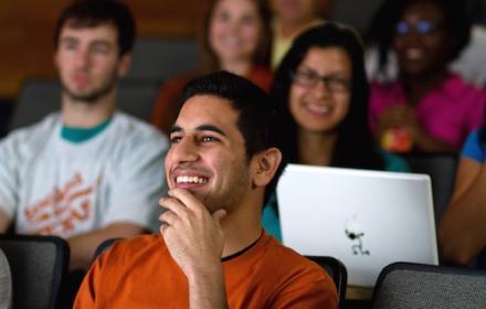 Students seated in auditorium classroom.